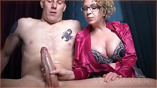 Amoral full-grown doll with blondie hair and glasses is groping manhood in front of the camera