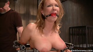 Big-Breasted Matriarch slave is chained and screwed