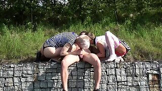 Slutty MILF deep throating changeless cock in threesome outdoor